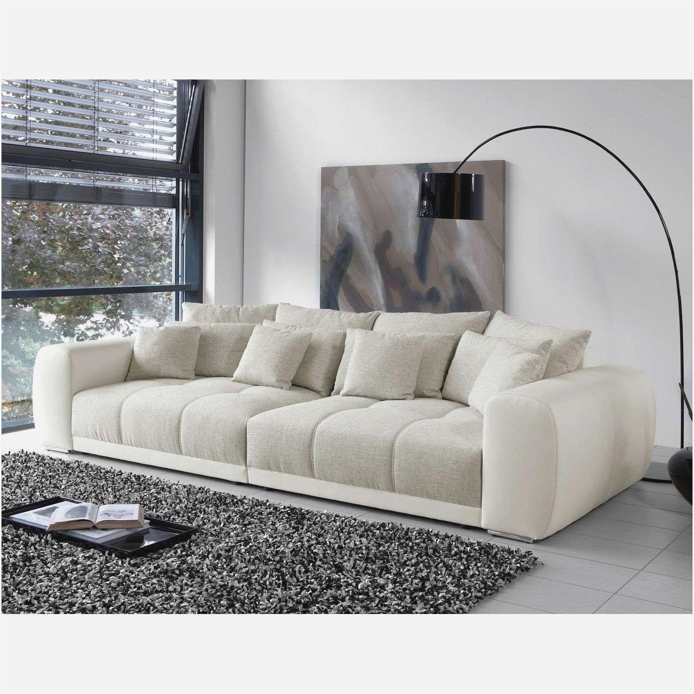 wohnzimmer ideen schwarzes sofa