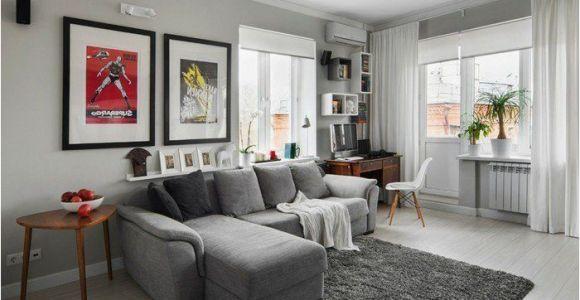Wohnzimmer Graues sofa Welche Wandfarbe Ein Graues sofa Grauer Teppich Bunte Bilder Weiße Gardine